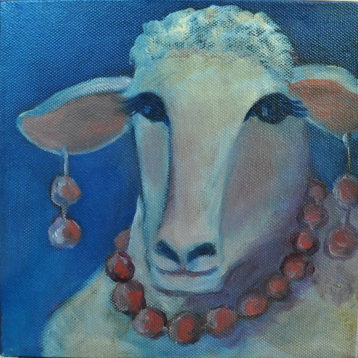 sheep with pink earrings and necklace
