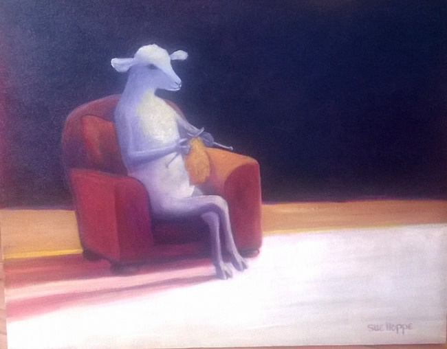 sheep knitting in red chair