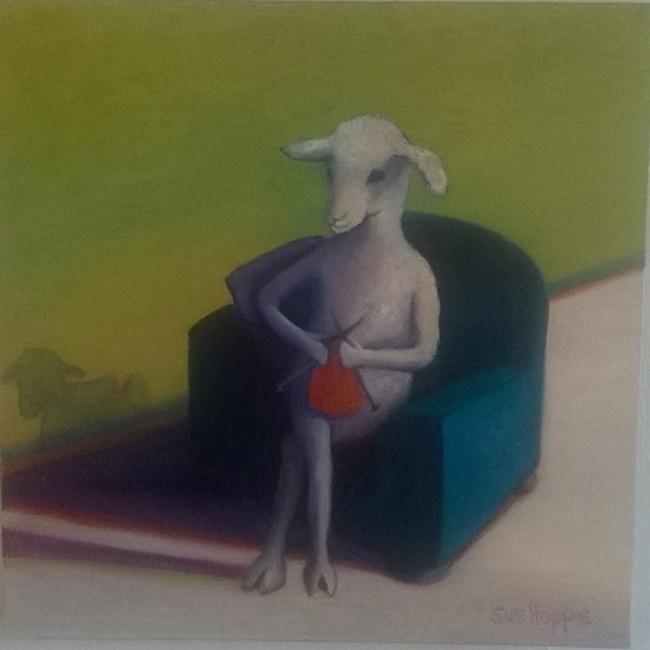 sheep knitting in a blue chair