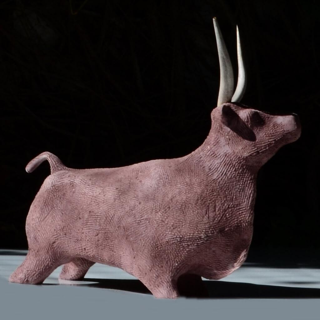 Bull ceramic sculpture with thorns.