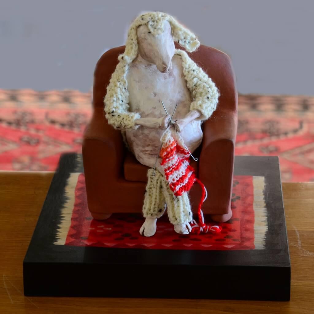 ceramic sculpture sheep knitting