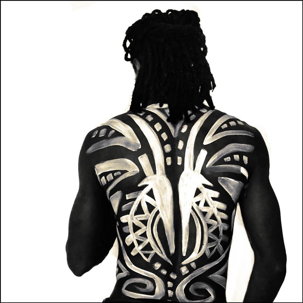 tribal body art on a male torso